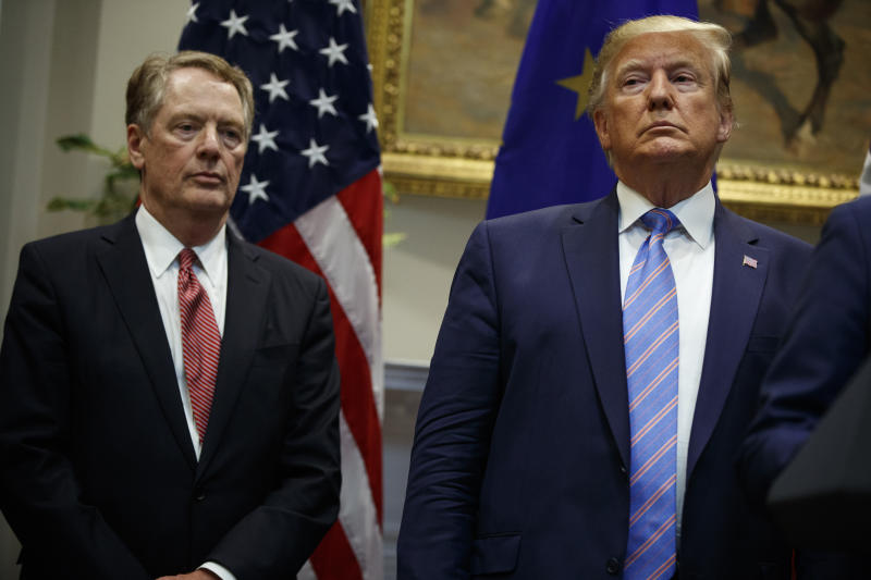 President Donald Trump stands with U.S. Trade Representative Robert Lighthizer during an event about expanding U.S. beef exports to the European Union, in the Roosevelt Room of the White House, Friday, Aug. 2, 2019, in Washington. (AP Photo/Evan Vucci)