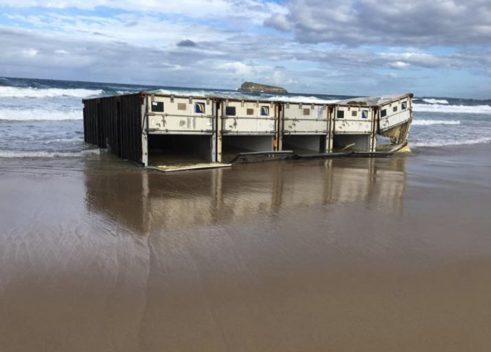 Five shipping containers washed up on Birdie Beach on Wednesday. Source: Facebook/ Erin Sampson