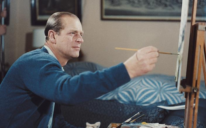 Prince Philip, Duke of Edinburgh pictured painting with oil colours at an easel during filming of the television documentary 'Royal Family' in London in 1969. - Rolls Press/Popperfoto