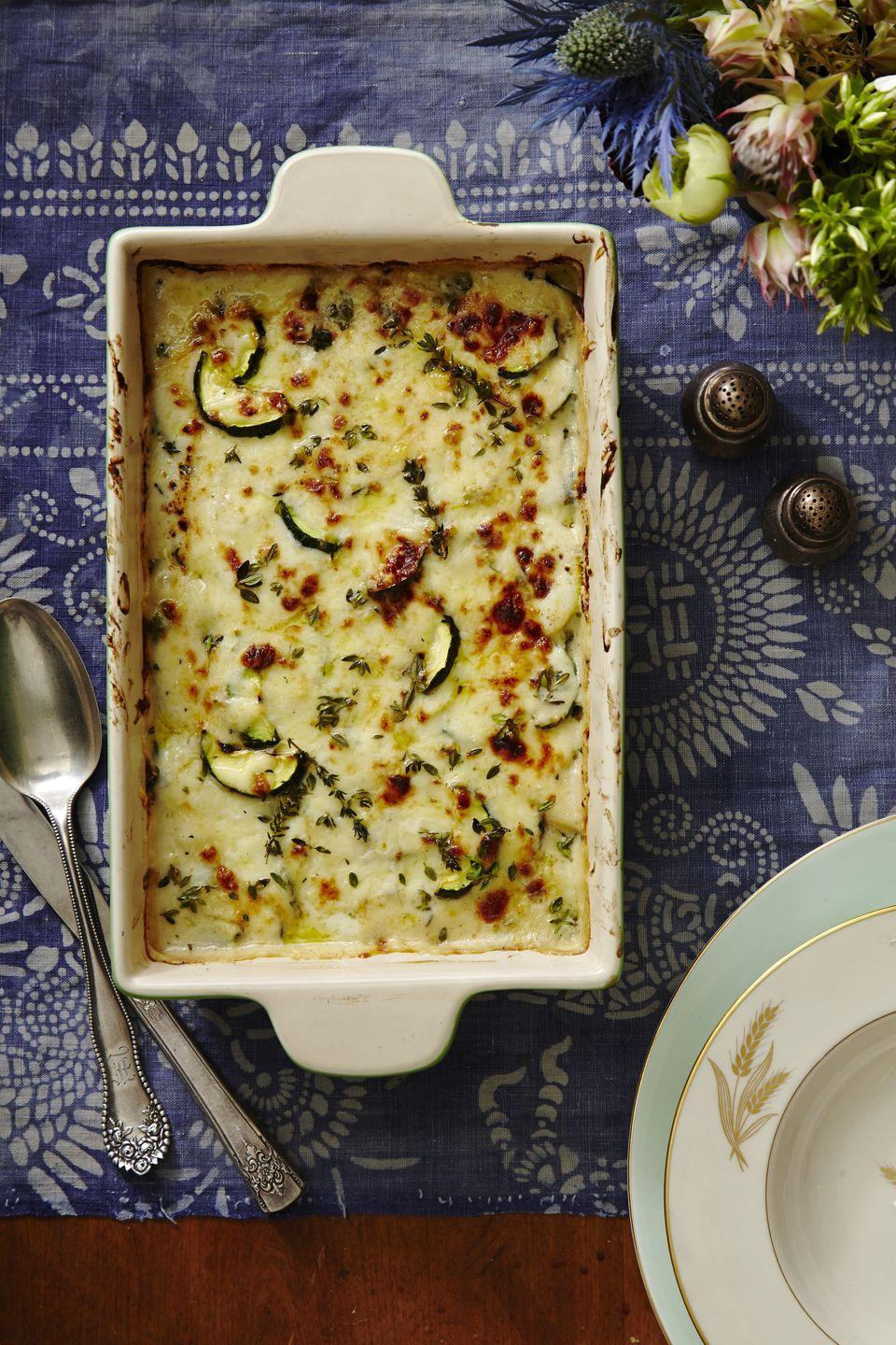 """<p>This creamy, decadent side dish is seriously making us reconsider our love for potatoes.</p><p><em><a href=""""https://www.goodhousekeeping.com/food-recipes/easy/a34576/thyme-scented-squash-gratin/"""" rel=""""nofollow noopener"""" target=""""_blank"""" data-ylk=""""slk:Get the recipe for Thyme-Scented Squash Gratin »"""" class=""""link rapid-noclick-resp"""">Get the recipe for Thyme-Scented Squash Gratin »</a></em></p>"""