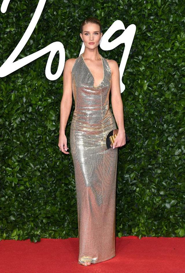 Rosie Huntingdon-Whiteley looked festive in a shimmery custom-made gown by Bottega Veneta [Photo: Getty]