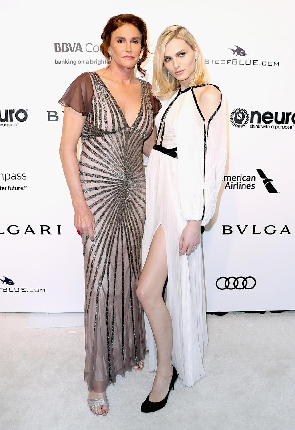 <p>Caitlyn Jenner rocked a sheer, sparkly gown designed by Rachel Gilbert at the Elton John AIDS Foundation bash. Model Andreja Pejic, who was the first transgender model to be profiled by <i>Vogue</i> magazine in 2015, accompanied her on the red carpet. (Photo by Frederick M. Brown/Getty Images) </p>