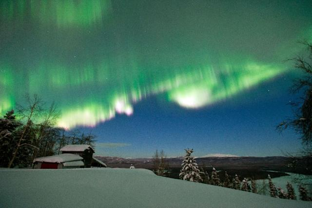 FILE - The northern lights are seen from Ruby, Alaska on March 8, 2012. Mitch Seavey is the first musher in the Iditarod Trail Sled Dog Race to reach the village of Ruby, on Friday, March 9, 2012, 480 miles from the finish line at Nome. (AP Photo/Anchorage Daily News, Marc Lester, File)