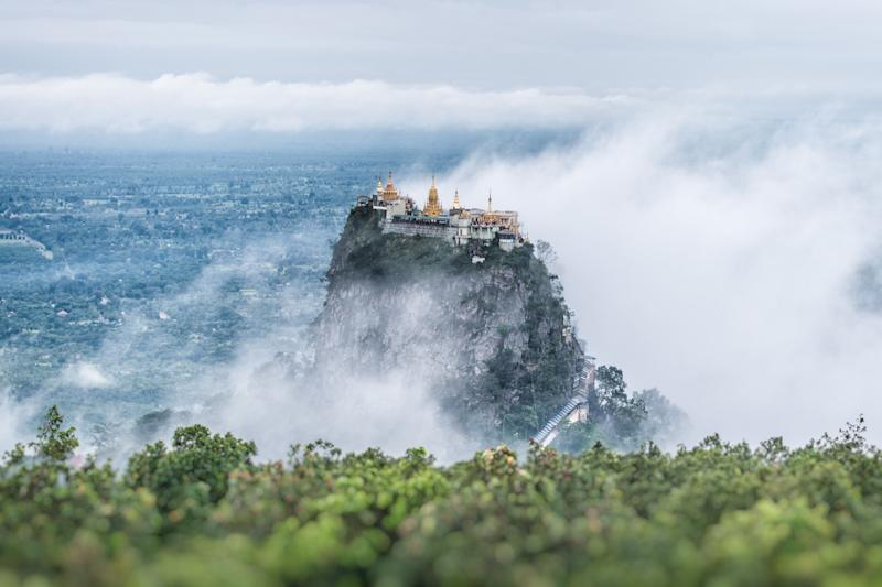 """Popa Taungkalat Monastery is situatedin the shadow of the nearbyMount Popa, a famous pilgrimage site in Myanmar. Visitors can <a href=""""https://www.go-myanmar.com/mount-popa"""" target=""""_blank"""">climb 777 steps</a> to this secluded Buddhist monasteryto explore numerous shrines and see breathtaking views of the surrounding mountains."""