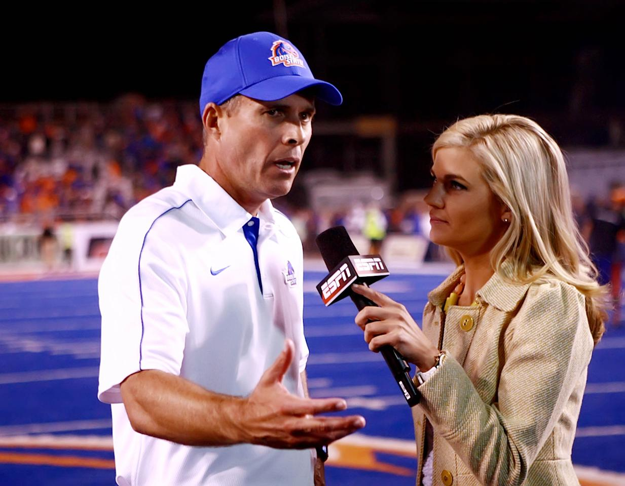 Boise State Broncos head coach Chris Petersen speaks with Samantha Steele after a game.