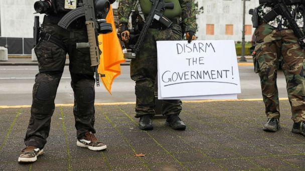 PHOTO: An armed group, who identify as 'Liberty Boys' and the anti-government group 'Boogaloo Bois' protest outside the Oregon State Capitol, as they advocate for less government control, in Salem, Oregon, U.S., Jan. 17, 2021. (Alisha Jucevic/Reuters)