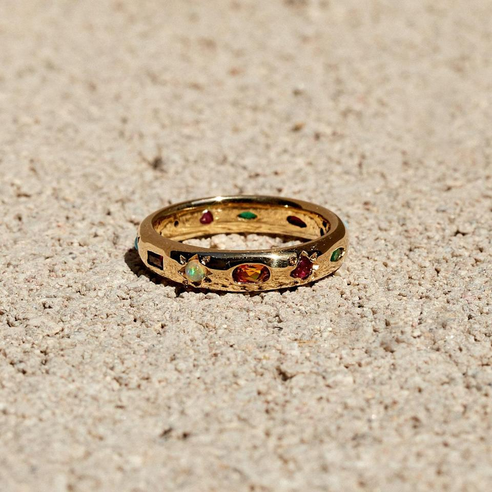 """For a minimalist-maximalist feel, opt for a ring that incorporates multiple stones. This band is set with seven different ones: ruby, turquoise, diamond, emerald, garnet, opal, and citrine. $2850, Leo Black. <a href=""""https://www.leoblackstudio.com/shop/treasure-chest-eternity-band"""" rel=""""nofollow noopener"""" target=""""_blank"""" data-ylk=""""slk:Get it now!"""" class=""""link rapid-noclick-resp"""">Get it now!</a>"""