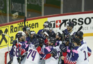 Britain's team players celebrate a victory after the Ice Hockey World Championship group A match between Belarus and Britain at the Olympic Sports Center in Riga, Latvia, Wednesday, May 26, 2021. (AP Photo/Roman Koksarov)