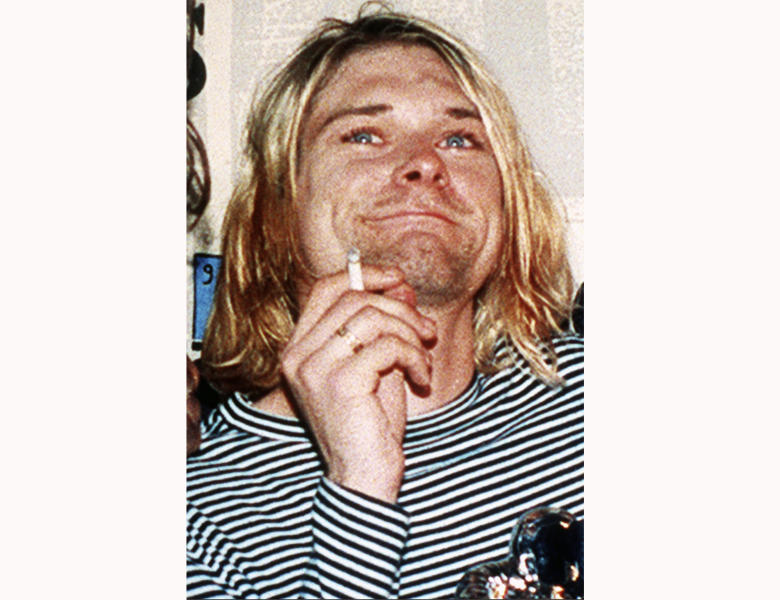 """FILE - This 1993 file photo shows Kurt Cobain, the lead singer of the U.S. rock band Nirvana. Grunge became gold Saturday, June 20, 2020, as the guitar Cobain played on Nirvana's 1993 """"MTV Unplugged"""" performance sold for an eye-popping $6 million at auction. (AP Photo/Mark J. Terrill, File)"""