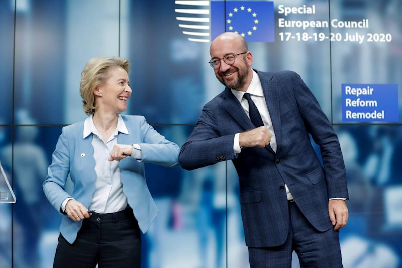 European Council President Charles Michel and European Commission President Ursula Von Der Leyen do an elbow bump at the end of a news conference (Reuters)