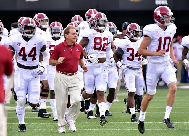 """NASHVILLE, TN – SEPTEMBER 23: Head coach Nick Saban of the <a class=""""link rapid-noclick-resp"""" href=""""/ncaab/teams/aaf/"""" data-ylk=""""slk:Alabama Crimson Tide"""">Alabama Crimson Tide</a> runs onto the field with his team prior to a game against the <a class=""""link rapid-noclick-resp"""" href=""""/ncaab/teams/vac/"""" data-ylk=""""slk:Vanderbilt Commodores"""">Vanderbilt Commodores</a> during the first half at Vanderbilt Stadium on September 23, 2017 in Nashville, Tennessee. (Photo by Frederick Breedon/Getty Images)"""