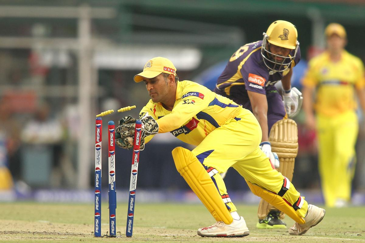 Chennai Super Kings captain MS Dhoni breaks the stumps to run out Yusuf Pathan of Kolkata Knight Riders during match 26 of the Pepsi Indian Premier League between The Kolkata Knight Riders and the Chennai Superkings held at the Eden Gardens Stadium in Kolkata on the 20th April 2013..Photo by Shaun Roy-IPL-SPORTZPICS  ..Use of this image is subject to the terms and conditions as outlined by the BCCI. These terms can be found by following this link:..https://ec.yimg.com/ec?url=http%3a%2f%2fwww.sportzpics.co.za%2fimage%2fI0000SoRagM2cIEc&t=1495647640&sig=2Yi7g7e6VIdb7rQP8UKOhg--~C