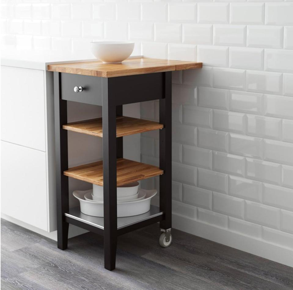 "<p>The <a href=""https://www.popsugar.com/buy/Stenstorp%20Kitchen%20Cart-446996?p_name=Stenstorp%20Kitchen%20Cart&retailer=ikea.com&price=119&evar1=casa%3Aus&evar9=46151613&evar98=https%3A%2F%2Fwww.popsugar.com%2Fhome%2Fphoto-gallery%2F46151613%2Fimage%2F46152185%2FStenstorp-Kitchen-Cart&list1=shopping%2Cikea%2Corganization%2Ckitchens%2Chome%20shopping&prop13=api&pdata=1"" rel=""nofollow noopener"" target=""_blank"" data-ylk=""slk:Stenstorp Kitchen Cart"" class=""link rapid-noclick-resp"">Stenstorp Kitchen Cart</a> ($119) gives you space to prep food, serve meals, and store kitchen supplies. Keep this compact piece stationary or move it to where you need it.</p>"