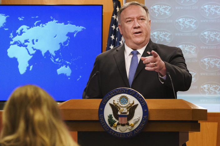 FILE - In this Nov. 10, 2020, file photo, Secretary of State Mike Pompeo gestures toward a reporter while speaking at the State Department in Washington. Pompeo plans to deliver a speech extolling the Trump administration's foreign policy this week in Georgia ahead of key Senate run-off elections that will determine control of the upper chamber of Congress. The accusation of genocide by U.S. Secretary of State Mike Pompeo against China touches on a hot-button human rights issue between China and the West. (AP Photo/Jacquelyn Martin, Pool, File)