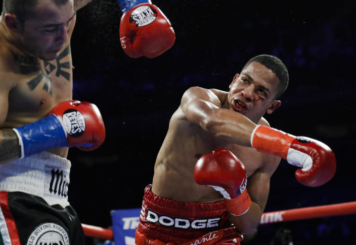 FiLE - In this April 20, 2019 file photo, Puerto Rico's Felix Verdejo, right, punches Costa Rica's Bryan Vazquez during the fifth round of a lightweight boxing match in New York. Verdejo has turned himself in to federal agents on Saturday, May 1, 2021, just hours after authorities identified the body of his 27-year-old lover Keishla Rodríguez in a lagoon in the U.S. territory, a couple of days after she was reported missing. (AP Photo/Frank Franklin II, File)