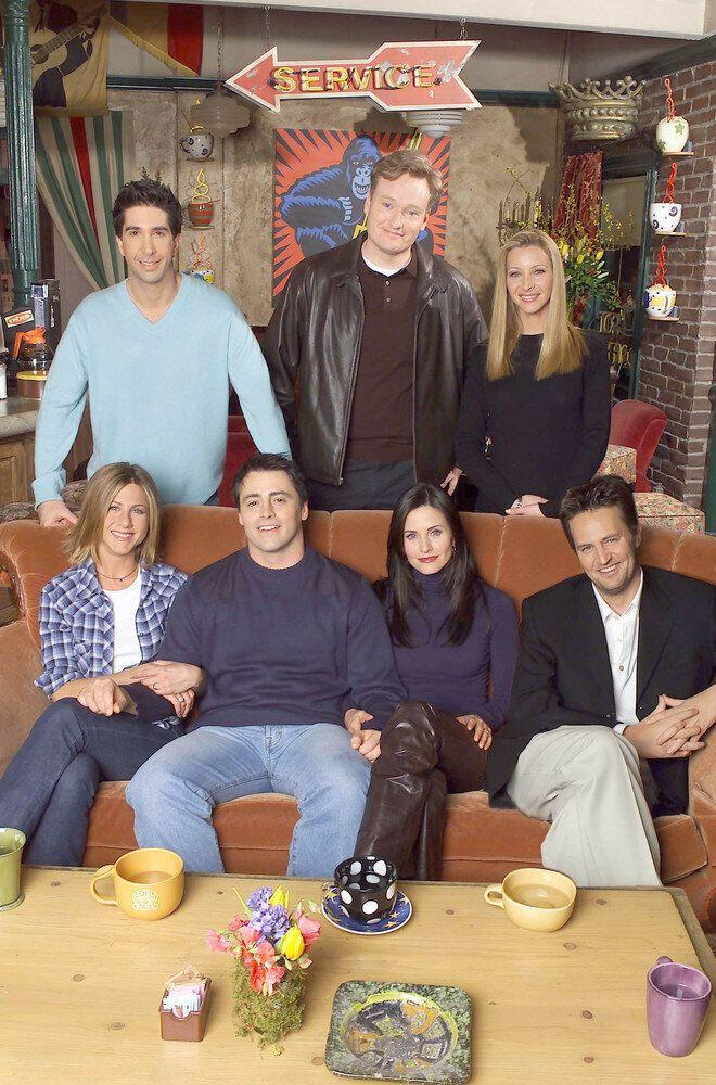 Cast members of NBC's comedy series 'Friends.' Pictured (l to r, seated): Jennifer Aniston, Matt LeBlanc, Courteney Cox and Matthew Perry (standing left) David Schwimmer, Lisa Kudrow (right) talk show host Conan O''Brien (center). Episode: 'Friends Out-takes & Bloopers Special.' (Photo by Warner Bros. Television)