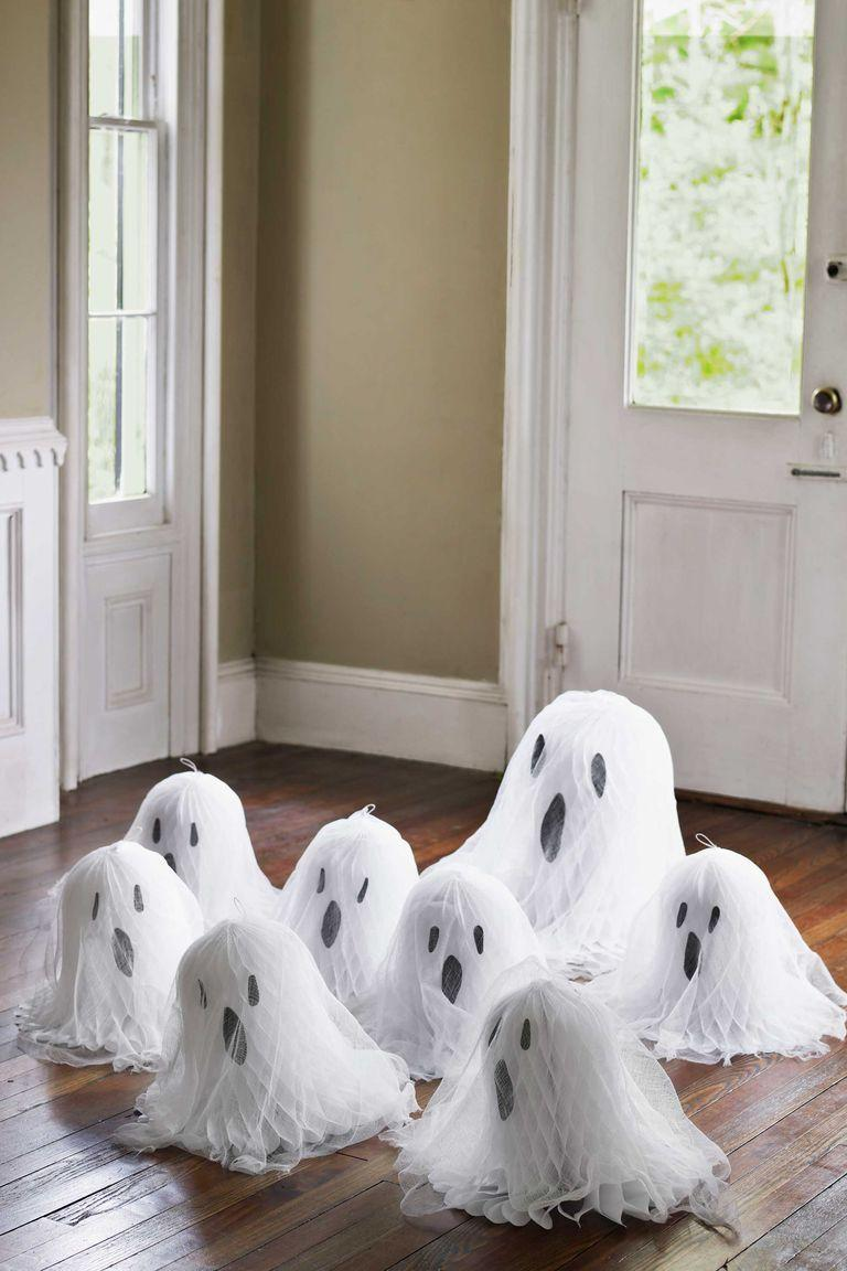 """<p>Transform paper honeycomb decorations into ghosts — friendly, frightful, or a mix of the two. To make, simply draw faces on the ghost-shaped decor with black Sharpie. </p><p><a class=""""link rapid-noclick-resp"""" href=""""https://www.amazon.com/Wrapables-A69063c-Honeycomb-Decorations-Weddings/dp/B012HL1J1I/?tag=syn-yahoo-20&ascsubtag=%5Bartid%7C10055.g.421%5Bsrc%7Cyahoo-us"""" rel=""""nofollow noopener"""" target=""""_blank"""" data-ylk=""""slk:SHOP HONEYCOMB BALLS"""">SHOP HONEYCOMB BALLS</a></p>"""