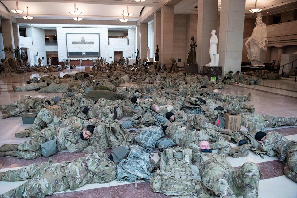 Members of the National Guard rest in the Capitol Visitors Center on Capitol Hill in Washington, DC, January 13, 2021 (Photo: SAUL LOEB via Getty Images)