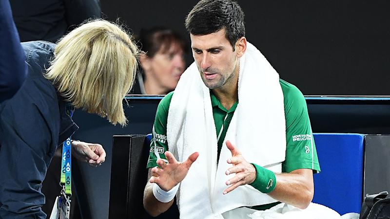 Novak Djokovic, pictured here receiving treatment during the Australian Open final.