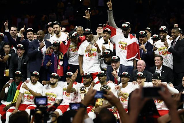 The Toronto Raptors celebrate with the Larry O'Brien Championship Trophy after their team defeated the Golden State Warriors to win Game Six of the 2019 NBA Finals at ORACLE Arena on June 13, 2019 in Oakland, California. (Photo by Ezra Shaw/Getty Images)