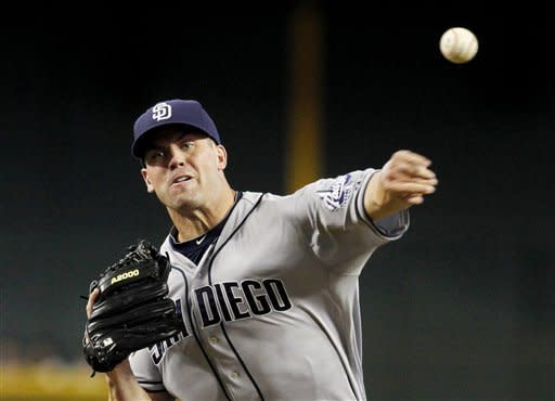 San Diego Padres' Clayton Richard throws against the Arizona Diamondbacks during the first inning of a baseball game on Saturday, Aug. 25, 2012, in Phoenix. (AP Photo/Ross D. Franklin)