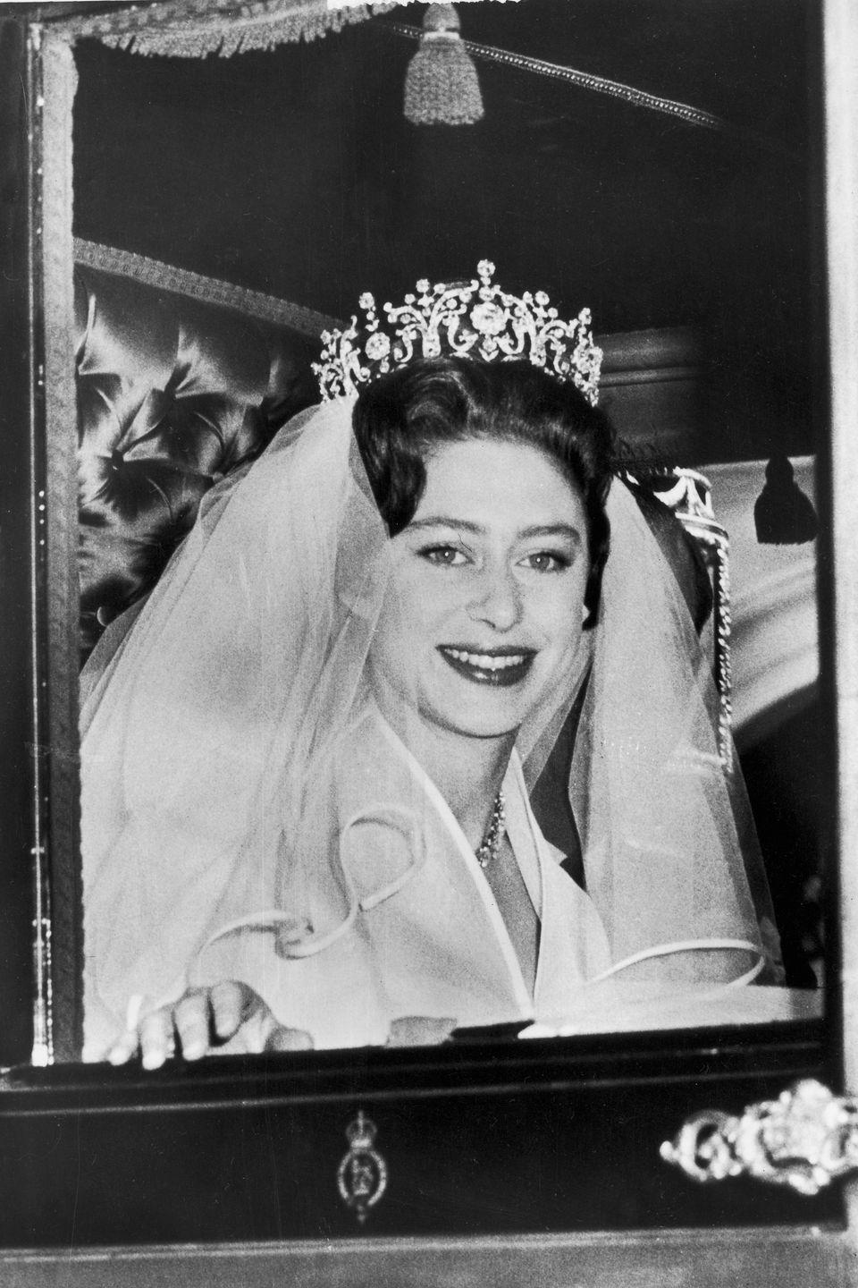 <p>Princess Margaret wore the Poltimore tiara for her wedding in 1960. The Garrard-made creation dates back to 1870, but the royal purchased it from the Poltimore family herself at auction for around $7,200.</p>