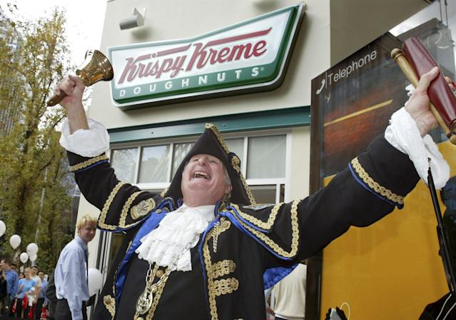 Sydney town Crier Graham Keating heralds the opening of a Krispy Kreme store in Sydney, May 2004. REUTERS