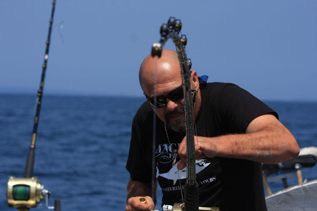 Gloucester, MA - Captain Dave Marciano throws his harpoon to finally bring the bluefin in.