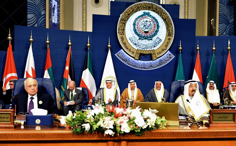Emir of Kuwait, Sheikh Sabah al-Ahmad al-Sabah, right, and Secretary-General of the League of Arab States, Nabil El Araby, left, attend the closing session of the Arab League Summit at Bayan Palace, Kuwait, Wednesday, March 26, 2014. (AP Photo/Nasser Waggi)