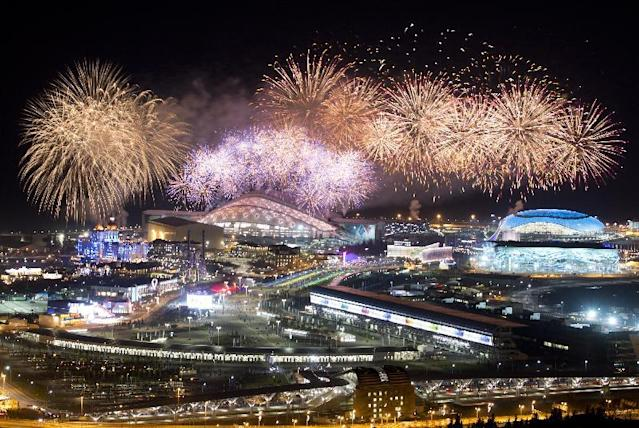 Fireworks explode over Olympic Park at the end of the closing ceremony of the 2014 Winter Olympics, Sunday, Feb. 23, 2014, in Sochi, Russia. (AP Photo/Pavel Golovkin)