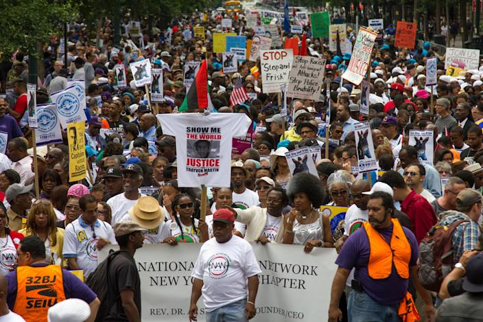 Thousands of people are seeing marching with signs calling for police reform.