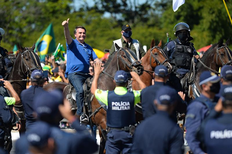 BRASILIA, BRAZIL - MAY 31: Brazilian President Jair Bolsonaro horse-riding duringa demonstrationin favor of his governmentamidstthe coronavirus pandemic in front of Planalto Palace on May 31, 2020 in Brasilia, Brazil. Brazil has over 498,000 confirmed positive cases of Coronavirus and 28,834 deaths. (Photo by Andressa Anholete/Getty Images)