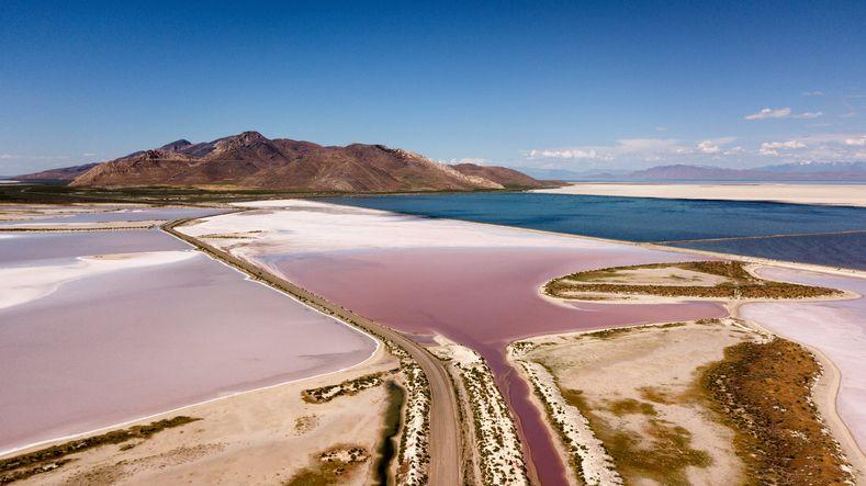 <p><strong>The </strong><strong>Great Salt Lake </strong>in Utah is the largest saltwater lake in the United States (and in the Western Hemisphere). It's known for the incredible pink and white salt reservoirs that form along its shores. </p>