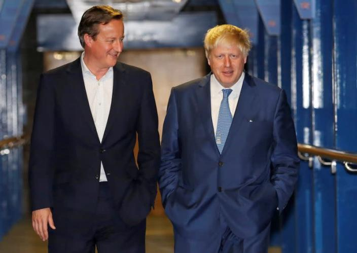 Britain's Prime Minister David Cameron and Mayor of London Boris Johnson walk to a function on the second day of the Conservative Party Conference in Birmingham