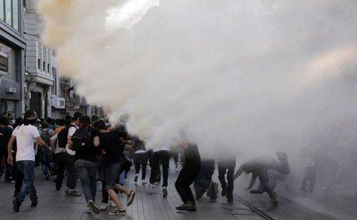 <p>Turkish police disperse anti-government protestors with water cannons during a protest near the entrance of Taksim Square on July 20, 2013, in Istanbul.</p>