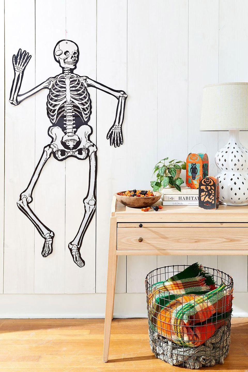 "<p>Even if it's just your crew this year, pull out all the <a href=""https://www.countryliving.com/entertaining/g271/halloween-decorating-1005/"" rel=""nofollow noopener"" target=""_blank"" data-ylk=""slk:fun Halloween party ideas"" class=""link rapid-noclick-resp"">fun Halloween party ideas</a> to ensure an absolutely spooktacular time.</p><p><a class=""link rapid-noclick-resp"" href=""https://www.amazon.com/Amscan-Halloween-Decoration-Jointed-Skeleton/dp/B0040IS3H0/?tag=syn-yahoo-20&ascsubtag=%5Bartid%7C2139.g.34440360%5Bsrc%7Cyahoo-us"" rel=""nofollow noopener"" target=""_blank"" data-ylk=""slk:SHOP SKELETON DECORATION"">SHOP SKELETON DECORATION</a></p>"