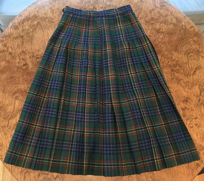 """<br><br><strong>BeholdersEyeBoutique</strong> Vintage J G Hook Pure Wool Plaid Wrap Skirt, $, available at <a href=""""https://go.skimresources.com/?id=30283X879131&url=https%3A%2F%2Fwww.etsy.com%2Flisting%2F847821517%2Fvintage-j-g-hook-pure-wool-green-and%3Fga_order%3Dmost_relevant%26ga_search_type%3Dall%26ga_view_type%3Dgallery%26ga_search_query%3Dplaid%2Bskirt%2Bvintage%26ref%3Dsr_gallery-1-23%26organic_search_click%3D1%26cns%3D1"""" rel=""""nofollow noopener"""" target=""""_blank"""" data-ylk=""""slk:Etsy"""" class=""""link rapid-noclick-resp"""">Etsy</a>"""