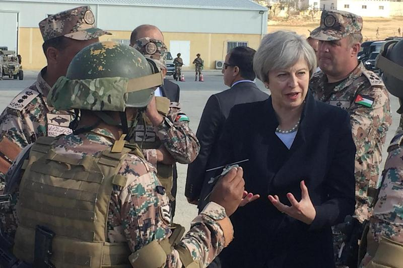 Mrs May speaks to troops as she arrives in Ammam, Jordan (PA)