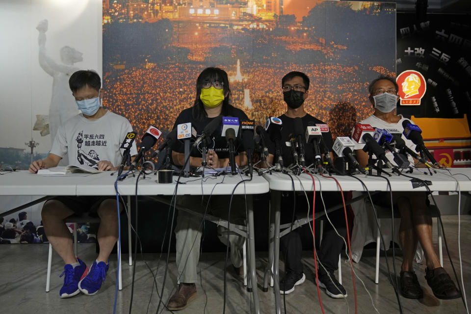 Chow Han Tung, vice chairwoman of the Hong Kong Alliance in Support of Patriotic Democratic Movements of China, second left, and other group members attend a news conference in Hong Kong, Sunday, Sept. 5, 2021. The group behind the annual Tiananmen Square memorial vigil in Hong Kong said Sunday it will not cooperate with police conducting a national security investigation into the group's activities, calling it an abuse of power. (AP Photo/Kin Cheung)