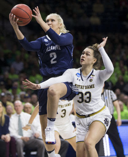 Villanova's Alex Louin (2) goes up for a shot over Notre Dame's Kathryn Westbeld (33) during a second-round game in the NCAA women's college basketball tournament Sunday, March 18, 2018, in South Bend, Ind. Notre Dame won 98-72. (AP Photo/Robert Franklin)