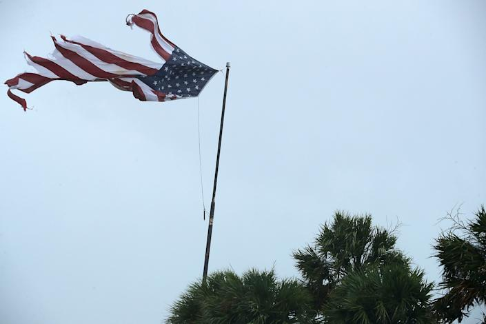 A U.S. flag is tattered by winds produced by Hurricane Irma in Fort Lauderdale.