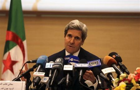 U.S. Secretary of State John Kerry gestures while addressing a news conference at the foreign ministry in Algiers