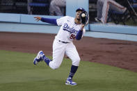 Los Angeles Dodgers' Mookie Betts catches a fly ball hit by San Francisco Giants' Mike Yastrzemski during the first inning of a baseball game Sunday, July 26, 2020, in Los Angeles. (AP Photo/Jae C. Hong)