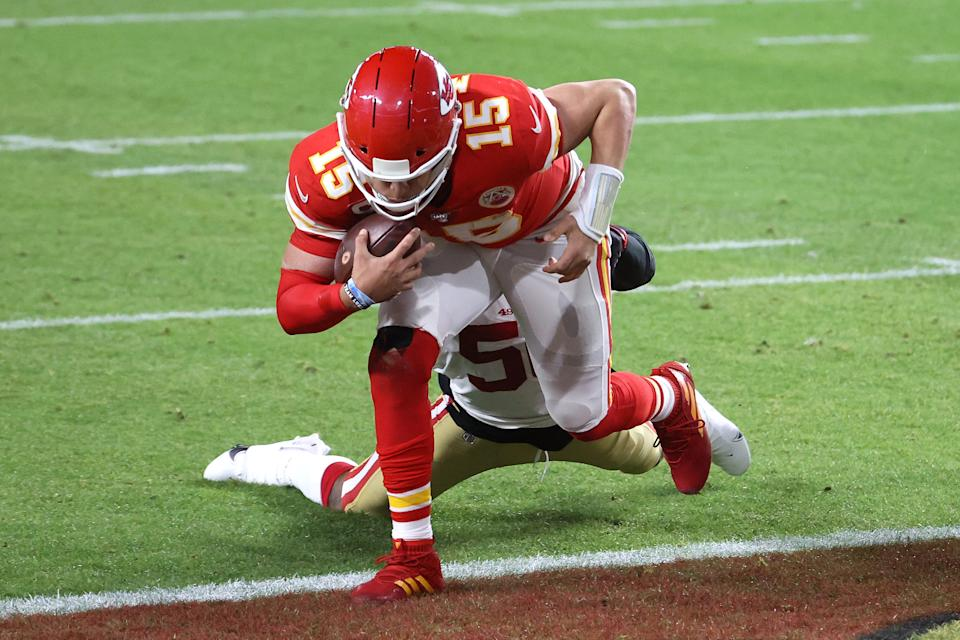 MIAMI, FLORIDA - FEBRUARY 02: Patrick Mahomes #15 of the Kansas City Chiefs runs for a touchdown against the San Francisco 49ers during the first quarter in Super Bowl LIV at Hard Rock Stadium on February 02, 2020 in Miami, Florida. (Photo by Al Bello/Getty Images)