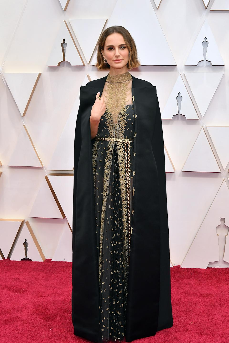 """The """"Black Swan"""" Oscar winner wore a caped gown by Christian Dior. Portman is set to serve as a presenter at this year's ceremony alongside actor Timothée Chalamet."""