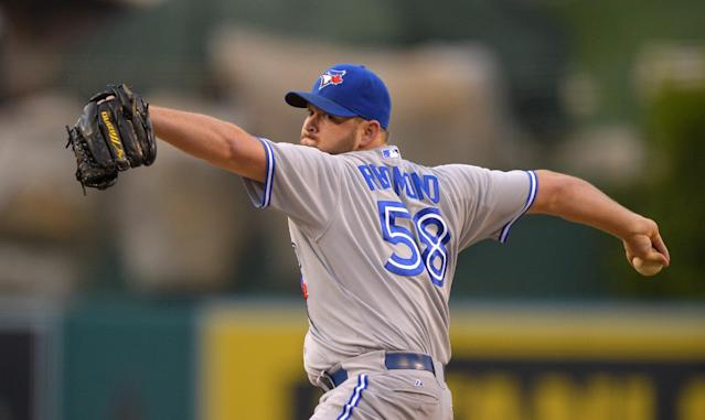 Toronto Blue Jays relief pitcher Todd Redmond throws to the plate during the first inning of their baseball game against the Los Angeles Angels, Friday, Aug. 2, 2013, in Anaheim, Calif. (AP Photo/Mark J. Terrill)