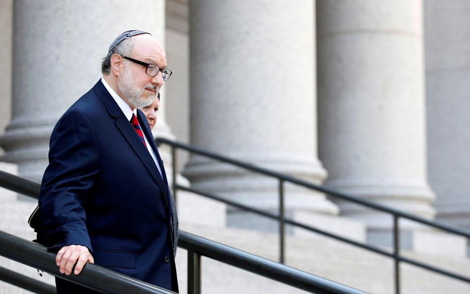 Jonathan Pollard, a former U.S. Navy intelligence officer convicted of spying for Israel, exits following a hearing at the Manhattan Federal Courthouse in New York - Reuters