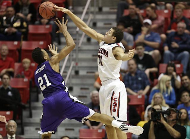 Arizona forward Aaron Gordon blocks the shot of Weber State's Joel Bolomboy during the first half in a second-round game in the NCAA college basketball tournament Friday, March 21, 2014, in San Diego. (AP Photo/Gregory Bull)