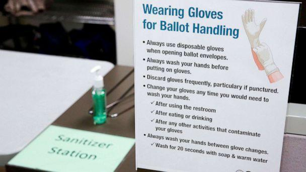 PHOTO: A hand sanitizer station is setup for election workers sorting vote-by-mail ballots for the presidential primary at King County Elections in Renton, Wash., March 10, 2020. (Jason Redmond/AFP via Getty Images)