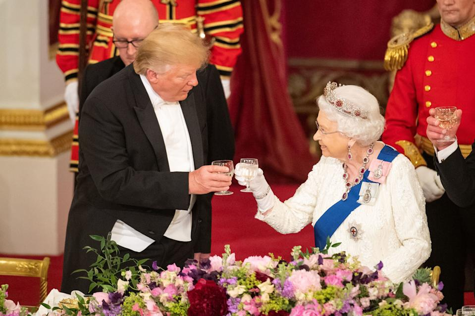 US President Donald Trump and Queen Elizabeth II make a toast during the State Banquet at Buckingham Palace, London, on day one of President Trump's three day state visit to the UK.